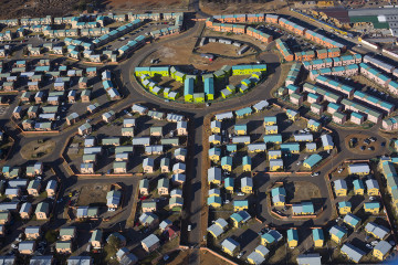 SOWETO, SOUTH AFRICA - JULY 19: An aerial view of newly constructed apartment complexes on July 19, 2018 in Kliptown section of Soweto, South Africa. Soweto has seen some of the largest developments in infrastructure with shopping malls, public transport etc. South Africa's largest township is now almost self-sufficient whereas before the residents had to buy things in Johannesburg. (Photo by Per-Anders Pettersson/Getty Images)